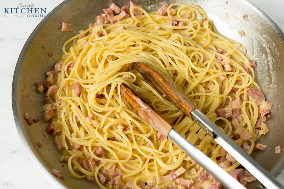 Bowl of Pasta Carbonara in Pan with Tongs